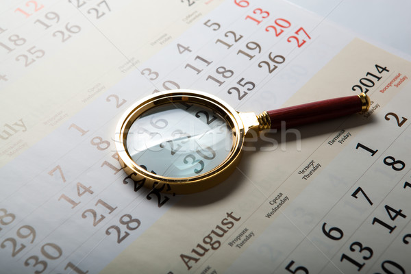 magnifier lying on the calendar Stock photo © mizar_21984