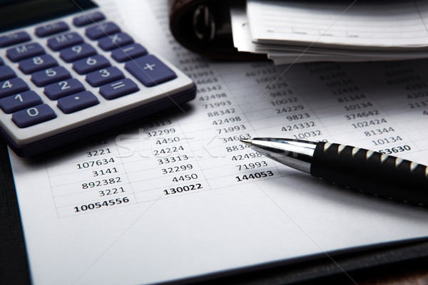 Stock photo: pen on background of calculator and accounting papers