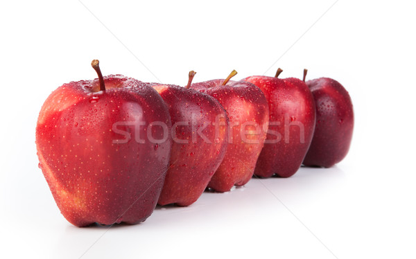 maroon apples lined up in a row closeup Stock photo © mizar_21984