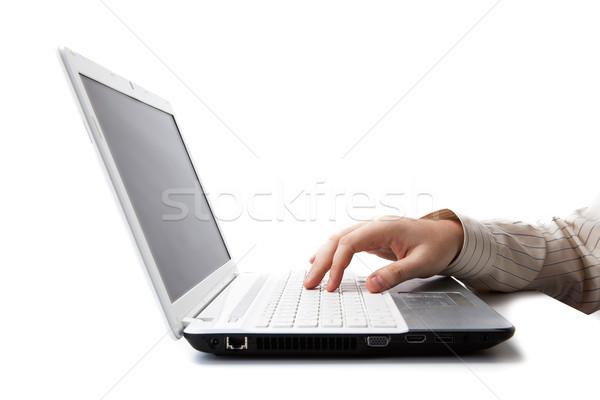 Mano uomo bugie tastiera del computer portatile bianco computer Foto d'archivio © mizar_21984