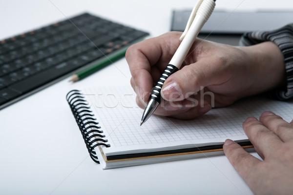 Mujer escrito trabajo diario mano humana Foto stock © mizar_21984