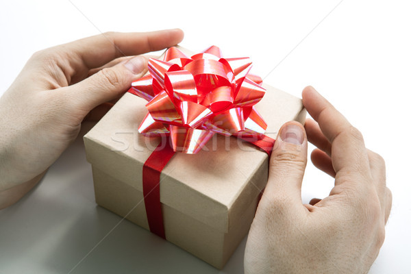 Man's hands give you a gift box Stock photo © mizar_21984