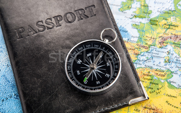 compass passport in cover and world map  Stock photo © mizar_21984