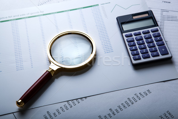 work with a magnifying glass, a calculator Stock photo © mizar_21984