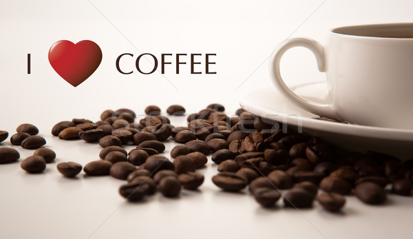 cup of black coffee with roasted coffe beans with title I love c Stock photo © mizar_21984