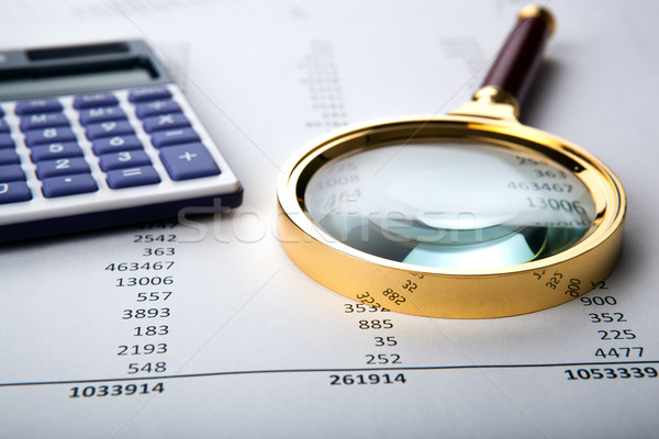 Stock photo: work with a magnifying glass, a calculator