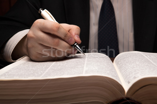 man is looking for information in the dictionary Stock photo © mizar_21984