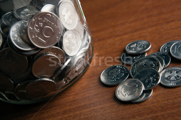 bank with coins and a bunch of Russian rubles coins Stock photo © mizar_21984