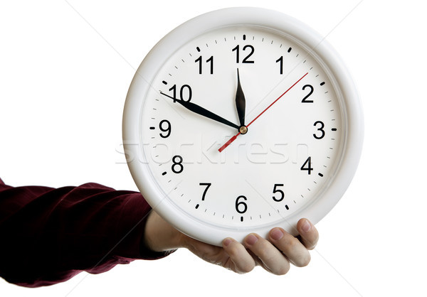 big round clock face in the man's hand on a white background Stock photo © mizar_21984