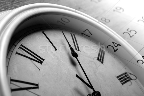 face clock and sheet of a calendar with the number of days Stock photo © mizar_21984