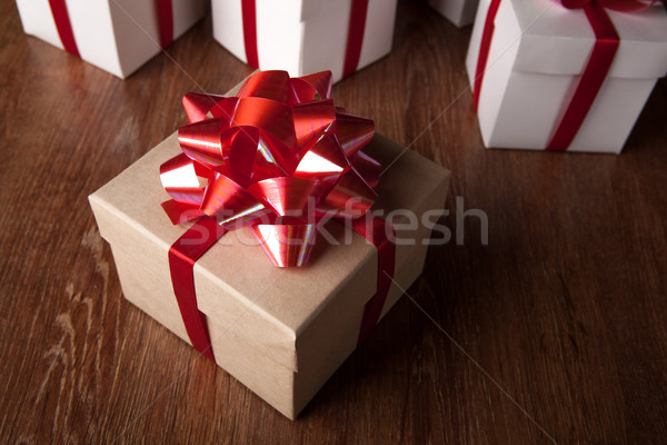 One festive gift box with a red bow against a background of whit Stock photo © mizar_21984