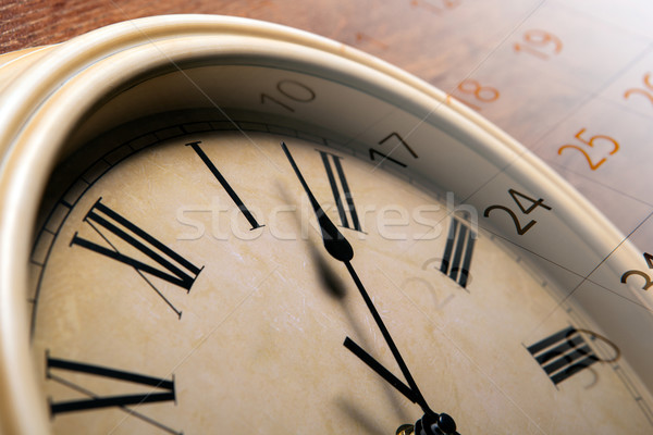 clock face with sheet of a calendar with the number of days Stock photo © mizar_21984