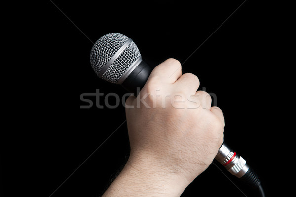 man's hand holding a microphone Stock photo © mizar_21984