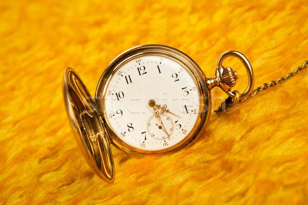 Oro reloj de bolsillo cubrir primer plano fondo Foto stock © mizar_21984