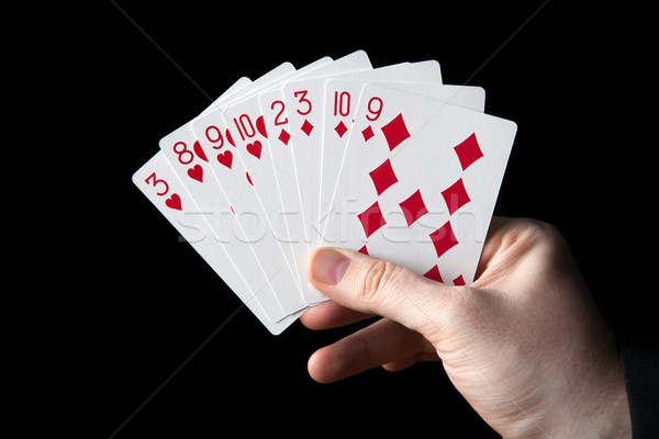 male hand holding a fan of playing cards Stock photo © mizar_21984
