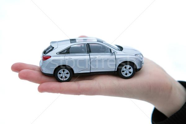 girl holds in her hand model of car Stock photo © mizar_21984