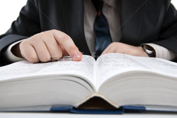 Uomo guardando informazioni dizionario primo piano business Foto d'archivio © mizar_21984