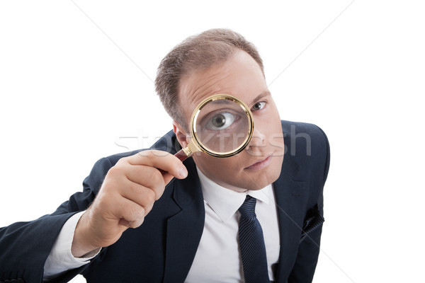 worker with a magnifying glass Stock photo © mizar_21984