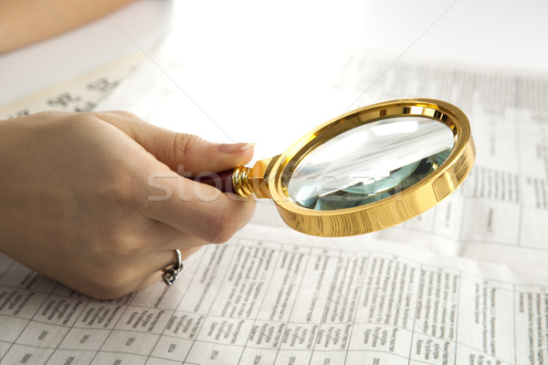 worker examines a magnifying glass text Stock photo © mizar_21984