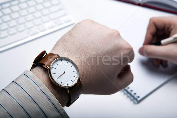Workplace businessman looks at the clock Stock photo © mizar_21984