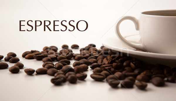 cup of black coffee with roasted coffe beans with title espresso Stock photo © mizar_21984