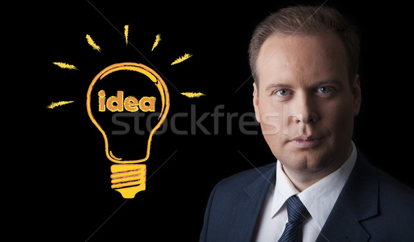 portrait of a man with an idea on a black background Stock photo © mizar_21984