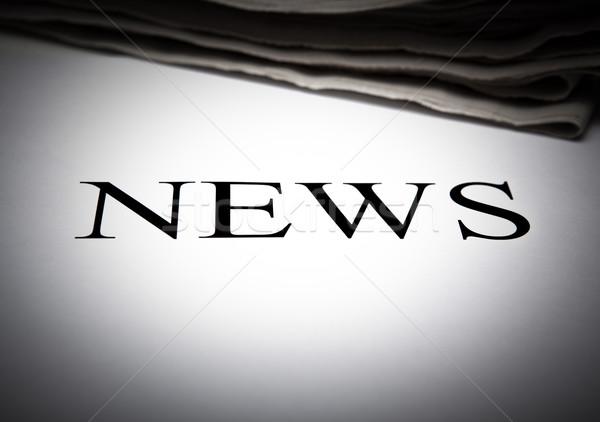 the word news on the background of a stack of newspapers Stock photo © mizar_21984