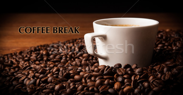 cup of black coffee with roasted coffe beans with title coffee b Stock photo © mizar_21984
