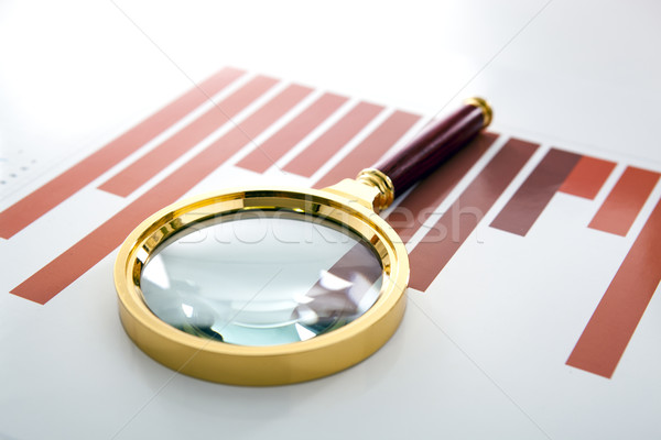 magnifier lies on the printed diagram Stock photo © mizar_21984