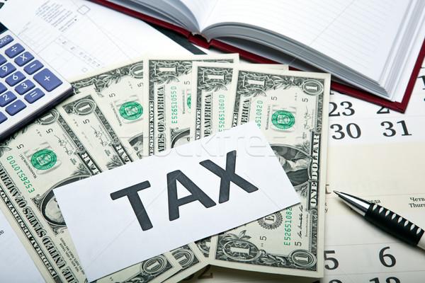 Contabilidade dinheiro dólares imposto voltar trabalhar Foto stock © mizar_21984