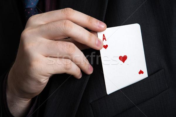 Adam dışarı oynama kart cep Stok fotoğraf © mizar_21984