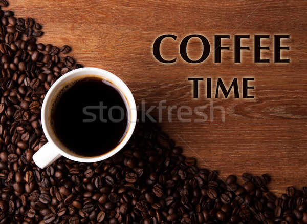 cup of black coffee with roasted coffe beans with title coffee t Stock photo © mizar_21984