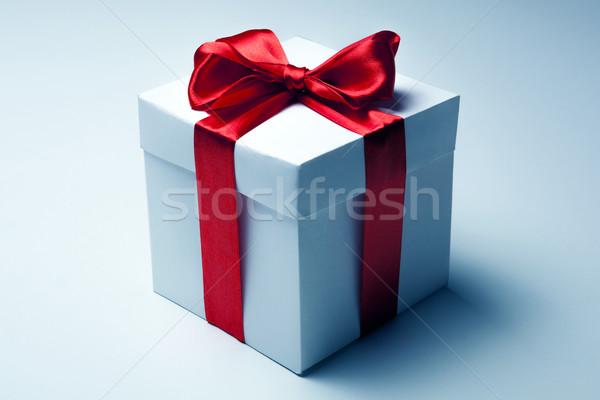 White gift box with red ribbon Stock photo © mizar_21984