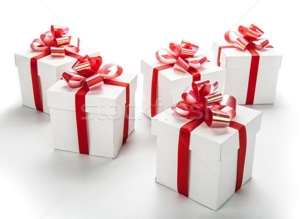 white festive gift boxes with red bows on a white Stock photo © mizar_21984