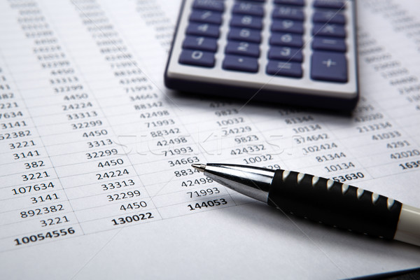 pen on background of calculator and accounting papers Stock photo © mizar_21984