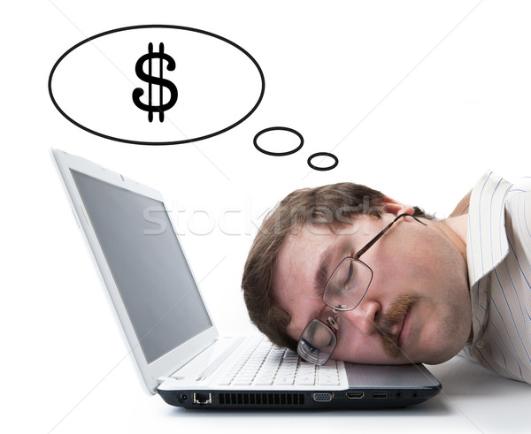 employee at the computer dreaming currency Stock photo © mizar_21984