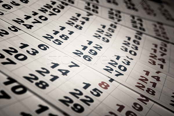 sheets of wall calendar with the number of days Stock photo © mizar_21984
