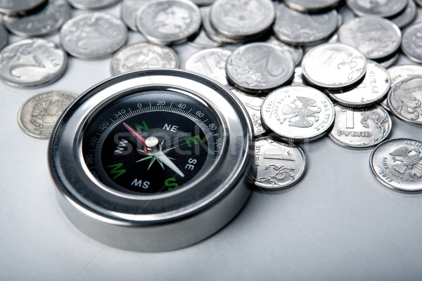 pile of coins with compass Stock photo © mizar_21984