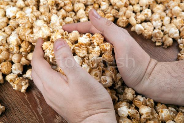 people gaining a bunch of popcorn Stock photo © mizar_21984
