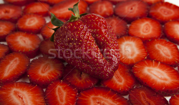 Fraise tranches fruits fond rouge usine Photo stock © mizar_21984