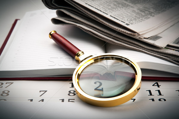 magnifier on the diary Stock photo © mizar_21984