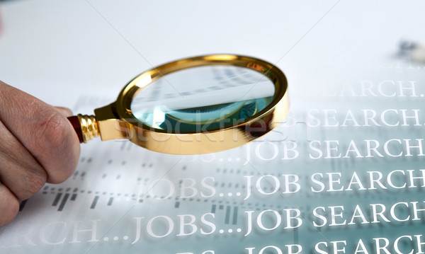inscription job search and a hand holding a magnifying glass Stock photo © mizar_21984