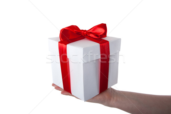 white gift box with red ribbon in hand Stock photo © mizar_21984