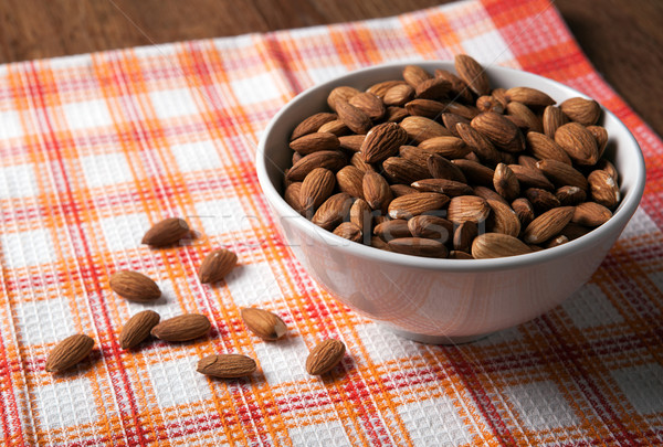 large grains of almonds in the shell and the bowl Stock photo © mizar_21984