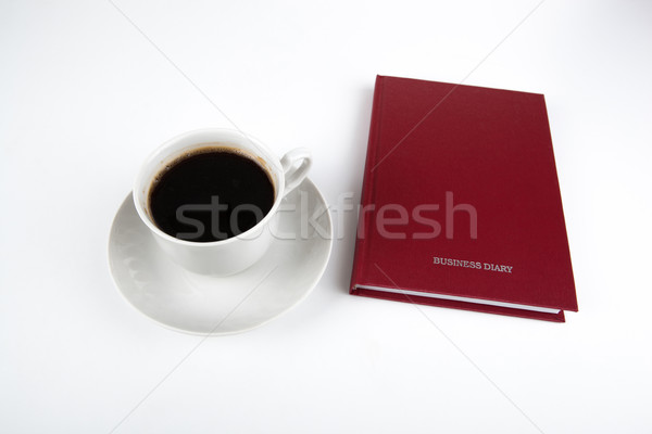 Stock photo: business diary with cup of coffee