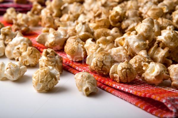 Stock photo: caramel popcorn on a napkin close up