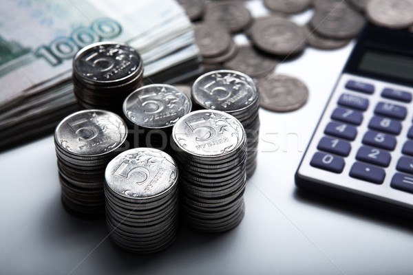 Stock photo: money in the form of banknotes and coins with calculator