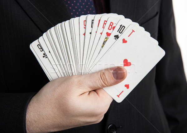 man holding a deck of cards in the form of a fan Stock photo © mizar_21984