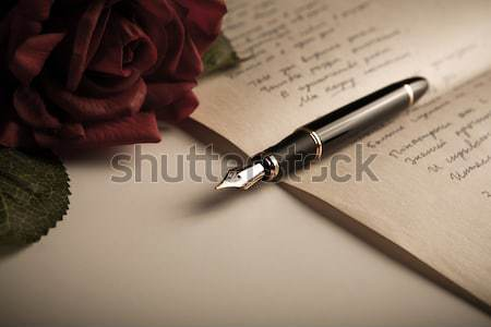 still life of a fountain pen, paper and flowers roses Stock photo © mizar_21984