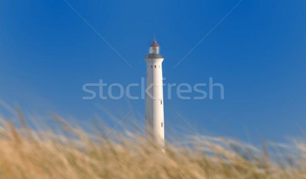 Blanco faro detrás duna mar Foto stock © mobi68